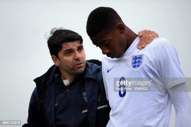 England U16's Head coach Dan Micciche speaks with Zech Medley