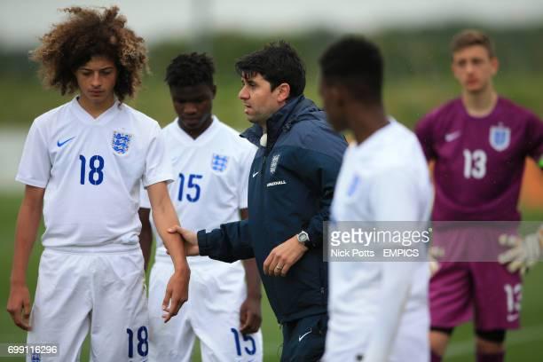 England U16's Head Coach Dan Micciche talks with Ethan Ampadu at half time