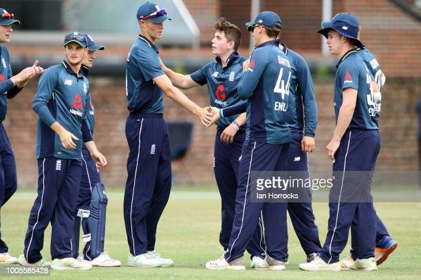 England U19 players celebrate the fall of the first South African wicket of Louis van Schalkwyk during the second ODI between England U19 and South...
