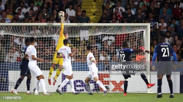 England U21 goalkeeper Dean Henderson tips a shot from France U21's Nanitamo Ikone over the crossbar during the UEFA European Under21 Championship...