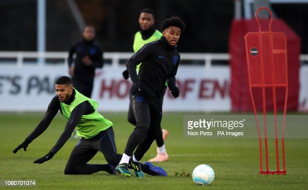 England U21's Reiss Nelson and Jake ClarkeSalter battle for the ball during the training session at St George's Park Burton