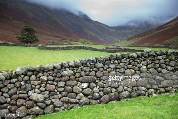 DISTRICT England UK Sculptural dry stone wall and low cloud in popular tourist site Burnthwaite at Wasdale Head the Lake District Cumbria England...