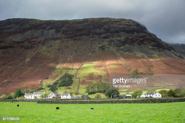 DISTRICT England UK Wasdale Hotel and farm buildings below Yewbarrow Fell mountain at Wasdale Head in the Lake District Cumbria England