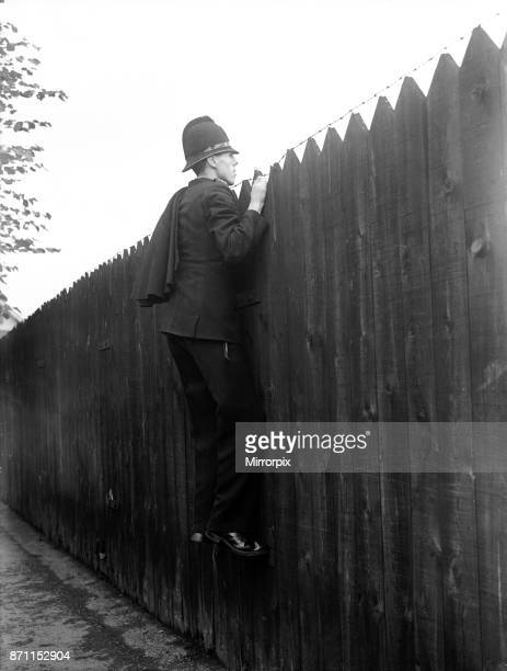 England V Australia 1954 4th Test Match Headingley Leeds. A policeman tasked with patrolling outside the Yorkshire Cricket Club in Headingley takes a...