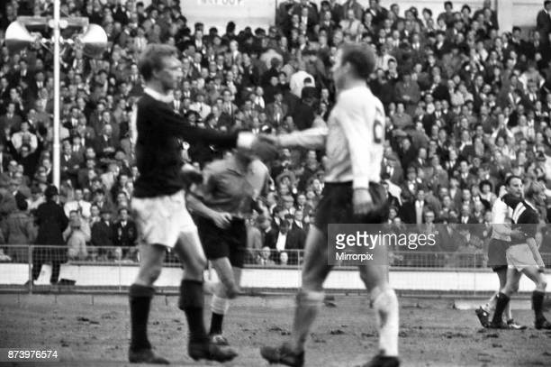 England v Scotland international football match at Wembley Stadium England captain Bobby Moore shakes hands with Denis Law at the end of the match...