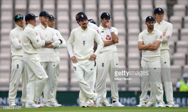 England watch the television replay after referring the wicket of John Campbell of the West Indies to the 3rd umpire during day two of the 1st...