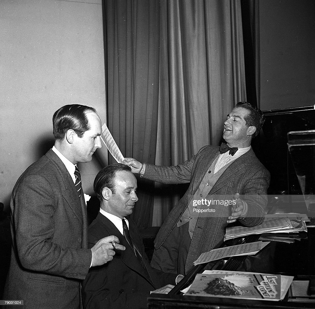 England, 1950, Welsh crooner and musician Donald Peers (right) is pictured with pianist Ernest Ponticelli and musical adviser Walley Ridley