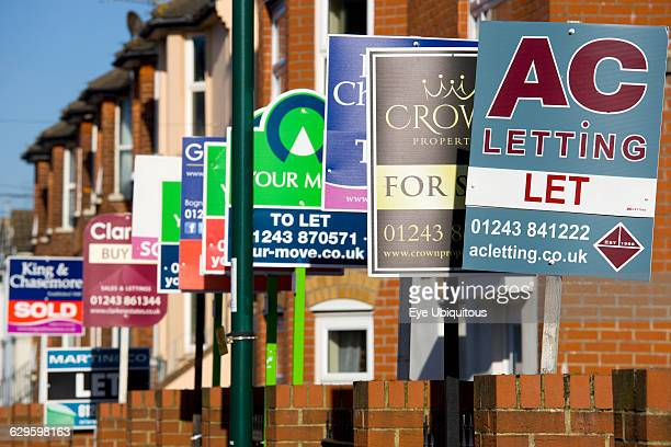 England West Sussex Bognor Regis a line of Estate Agents signs along a terrace of houses