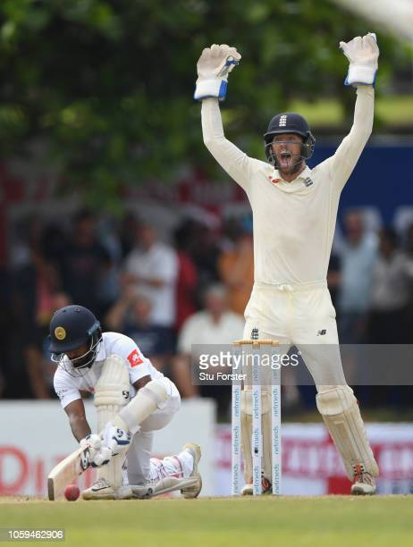 England wicket keeper Ben Foakes appeals with success as bowler Jack Leach traps Sri Lanka batsman Kaushal Silva LBW during Day Four of the First...