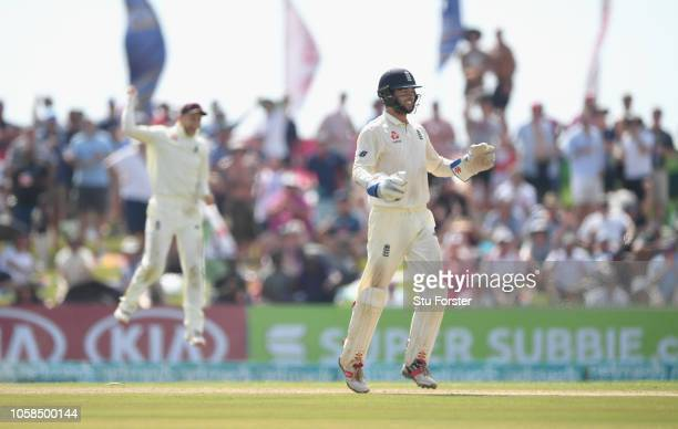 England wicket keeper Ben Foakes celebrates with Joe Root after stumping Dinesh Chandimal during Day Two of the First Test match between Sri Lanka...