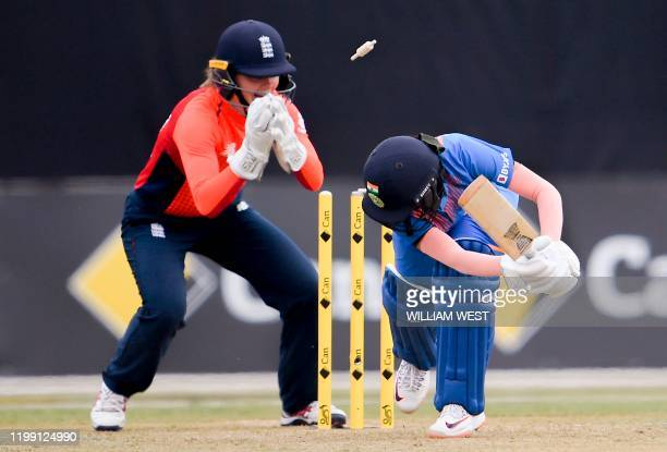 England wicketkeeper Amy Jones stumps India's batswoman Jemimah Rodrigues during their women's T20 International cricket match in Melbourne on...