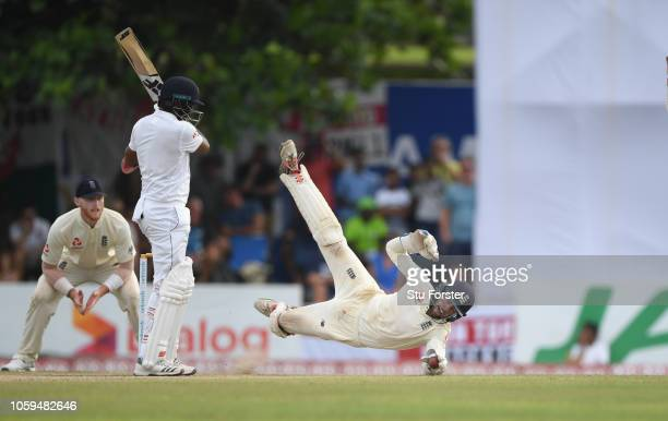 England wicketkeeper Ben Foakes makes an acrobatic attempt to catch Sri Lanka batsman Dilruwan Perera during Day Four of the First Test match between...