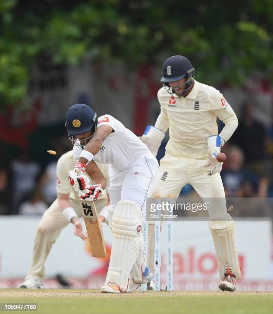 England wicketkeeper Ben Foakes reacts as Sri Lanka batsman Dinesh Chandimal is bowled by Jack Leach during Day Four of the First Test match between...