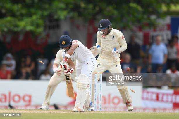 England wicketkeeper Ben Foakes reacts as Sri Lanka batsman Dinesh Chandimal is bowled by bowler Jack Leach during Day Four of the First Test match...