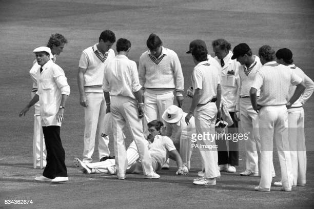 England wicket-keeper Bruce French getting attention before being wheeled off the pitch when he collapsed after being hit on the head by a ball.
