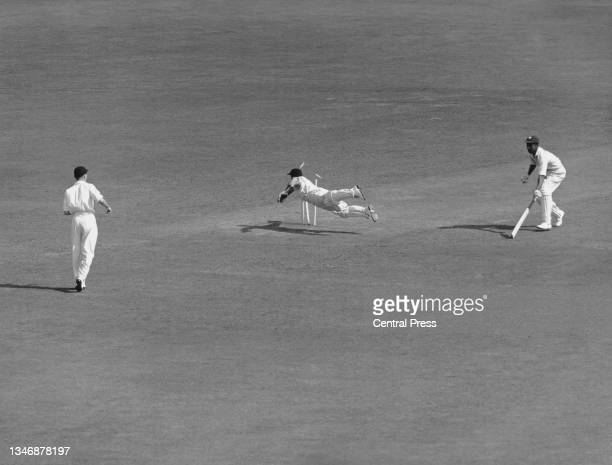 England wicketkeeper Godfrey Evans makes a diving attempt to run out West Indies batsman Frank Worrell during the first innings of the Third Test...