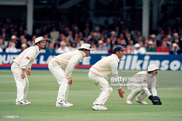 England wicketkeeper Jack Russell and slip fielders Graham Thorpe Graeme Hick and Nasser Hussain wait for a chance during the 2nd Test match between...