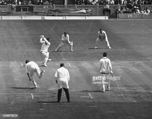 England wicketkeeper Jim Parks and slip fielder Colin Cowdrey look on as batsman Garfield Sobers, captain of the West Indies cricket team plays a...