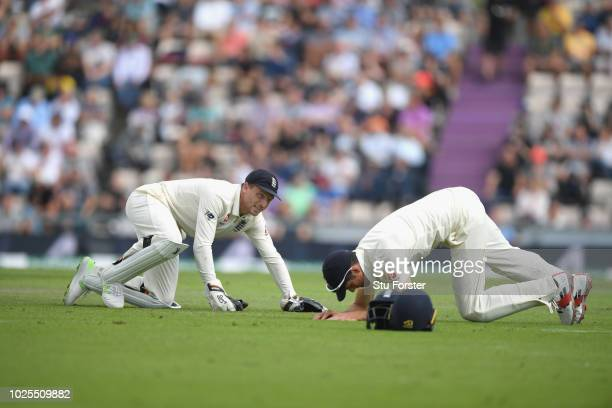England wicketkeeper Jos Buttler and slip fielder Alastair Cook react after a chance goes begging during day two of the 4th Specsavers Test match...