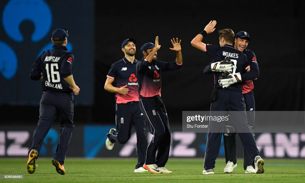 England wicketkeeper Jos Buttler and team mates rush to congratulate bowler Chris Woakes after the last delivery means England win the match during the 3rd ODI between New Zealand and England at Westpac stadium on March 3, 2018 in Wellington, New Zealand.