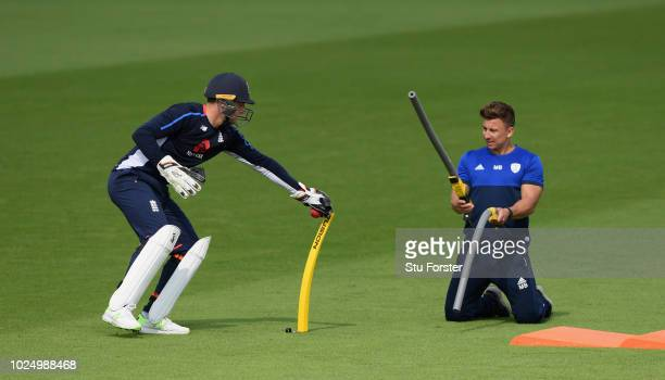 England wicketkeeper Jos Buttler does a practice drill with Michael Bates during England nets ahead of the 4th Test Match against India at The Ageas...