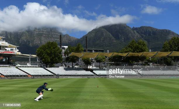 England wicketkeeper Jos Buttler in action infront of a cloud covered Table Mountain after England training at Newlands ahead of the 2nd Test Match...