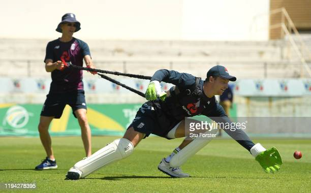 England wicketkeeper Jos Buttler in action with Mark Saxby holding the reins during England nets at Willowmoore Park during the England Media Access...
