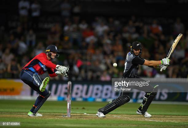 England wicketkeeper Jos Buttler looks on as Martin Guptill cuts towards the boundary during the International Twenty20 match between New Zealand and...