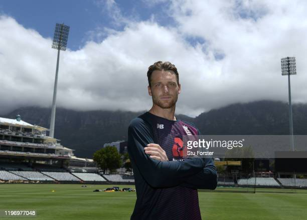 England wicketkeeper Jos Buttler poses for a picture infront of a cloud covered Table Mountain after England training at Newlands ahead of the 2nd...