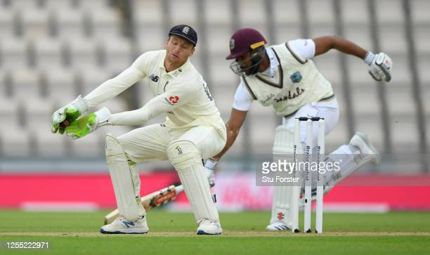 England wicketkeeper Jos Buttler receives the ball as Kraigg Brathwaite of the West Indies makes his ground during day two of the 1st #RaiseTheBat...