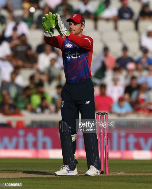 England wicketkeeper Jos Buttler takes a ball during the 3rd Vitality T20 match between England and Pakistan at Emirates Old Trafford on July 20,...