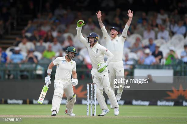 England wicketkeeper Jos Buttler takes the catch for the wicket of South Africa batsman Dean Elgar as Ben Stokes appeals, the decision was given...