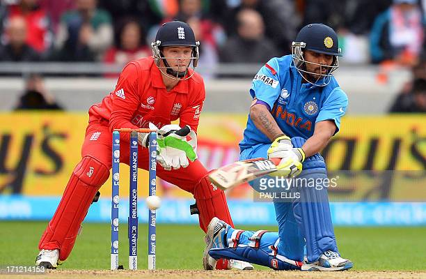 England wicketkeeper Jos Buttler watches India's Ravindra Jadeja plays a shot during the 2013 ICC Champions Trophy Final cricket match between...