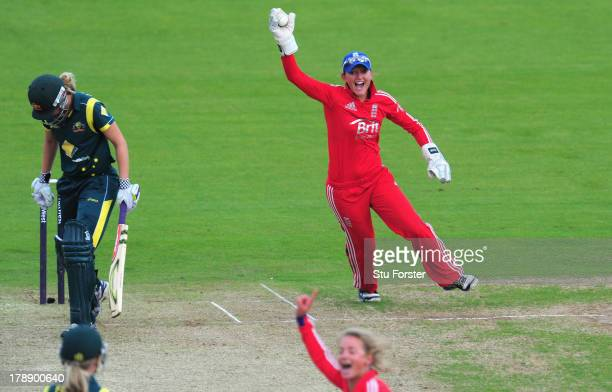 England wicketkeeper Sarah Taylor celebrates after catching Australia batsman Meg Lanning during the Women's Ashes Series 3rd NatWest T20 between...