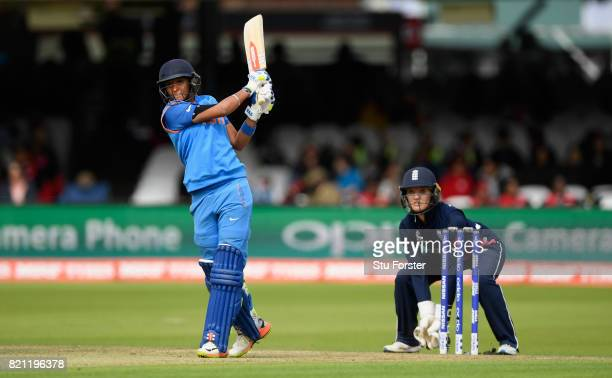 England wicketkeeper Sarah Taylor looks on as Harmanpreet Kaur hits out during the ICC Women's World Cup 2017 Final between England and India at...