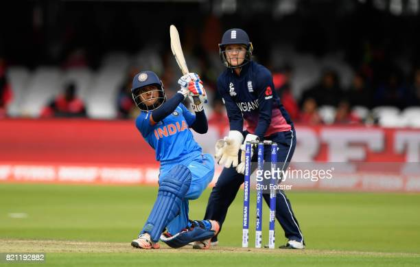 England wicketkeeper Sarah Taylor looks on as Punam Raut hits out during the ICC Women's World Cup 2017 Final between England and India at Lord's...