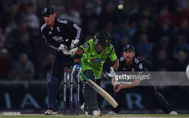 England wicketkeeper Steven Davies and Paul Collingwood look on as Pakistan batsman Fawad Alam is bowled by Graeme Swann during the 5th NatWest ODI...