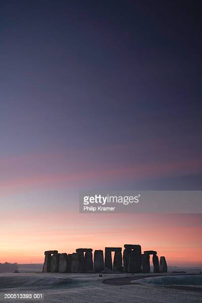 England, Wiltshire, Stonehenge at dawn, winter