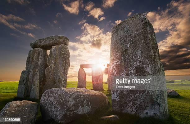 uk, england, wiltshire, stonehenge at sunset - stonehenge stock photos and pictures