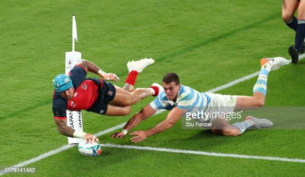 England wing Jack Nowell dives over to score the 5th try despite the attentions of Argentina player Emiliano Boffelli during the Rugby World Cup 2019...