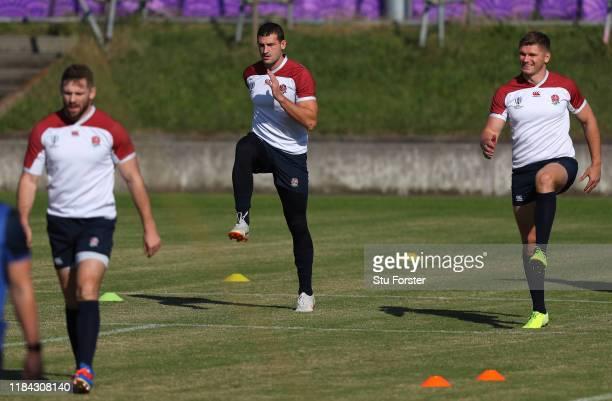 England wing Jonny May and Owen Farrell warm up during England training at Fuchu Asahi Football Park on October 30, 2019 in Fuchu, Japan.