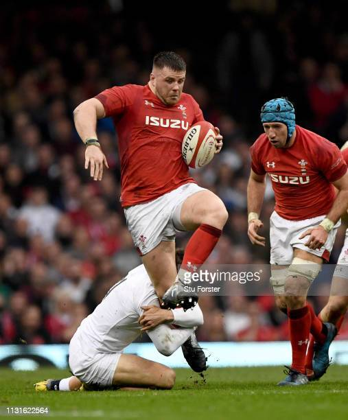 England wing Jonny May gets to grips with Wales prop Rob Evans during the Guinness Six Nations match between Wales and England at Principality...