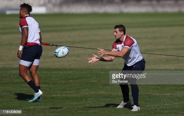 England wing Jonny May in action as Anthony Watson looks on during England training at Fuchu Asahi Football Park on October 30, 2019 in Fuchu, Japan.