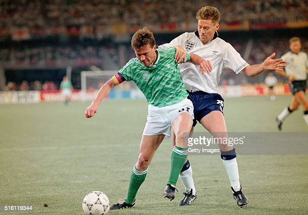 England winger Chris Waddle challenges West Germany captain Lothar Matthäus during the 1990 FIFA World Cup Semi Final at Stadio delle Alpi on July...