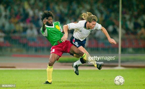 England winger Chris Waddle is challenged by Jean-Claude Pagal of Cameroon during the 1990 FIFA World Cup Quarter Final match on July 1, 1990 in...