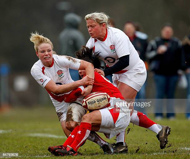 England winger Francesca Matthews and scrum half Amy Turner tackle a Wales player during the Womens 6 Nations game between Wales and England at Taffs...