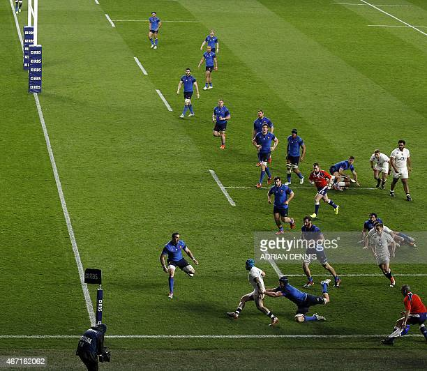 England winger Jack Nowell breaks a tackle on his way to scoring a try near the end of the second half during the Six Nations international rugby...