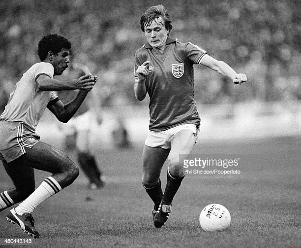 England winger Peter Barnes moves past Toninho Cerezo of Brazil during the International friendly match between England and Brazil at Wembley Stadium...