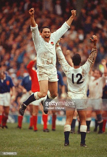 England winger Rory Underwood jumps in celebration as England defeat France 2119 to win the Grand Slam at the Five Nations Championship on 16th March...