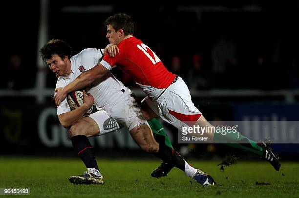 England winger Sam Smith is tackled by Wales centre Scott Williams during the International match between England U20 and Wales U20 International...